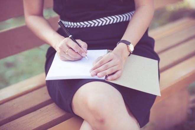 woman writing note
