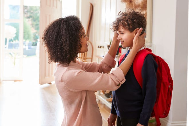 Mum and son in corridor of home ready to leave for school