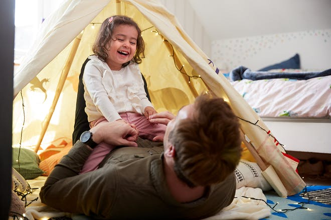 Daughter and dad building den