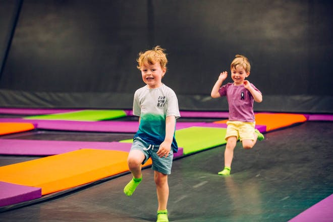 two boys running at trampoline park