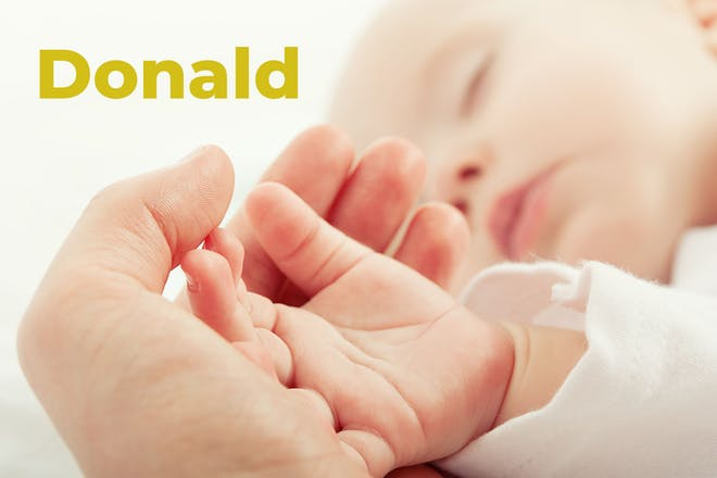 Sleeping baby with parent holding hand. Name Donald is written in text