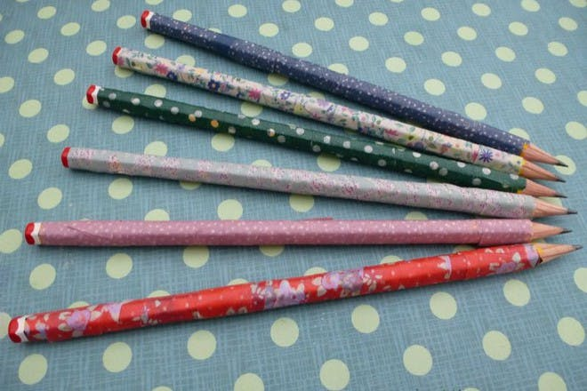 colourful patterned pencils on patterned background