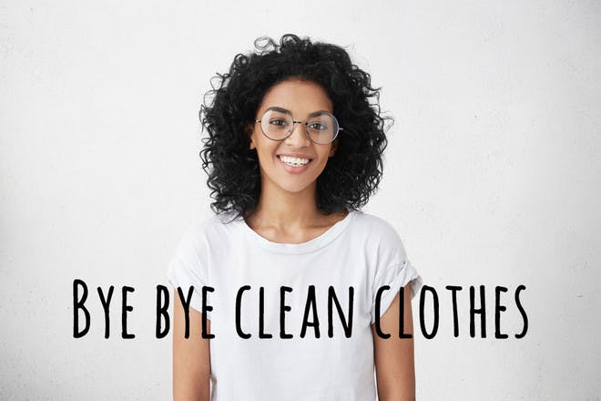 Lady wearing glasses in white t-shirt