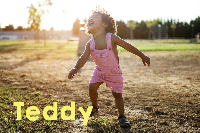 Toddler in dungarees dancing outside. text says Teddy