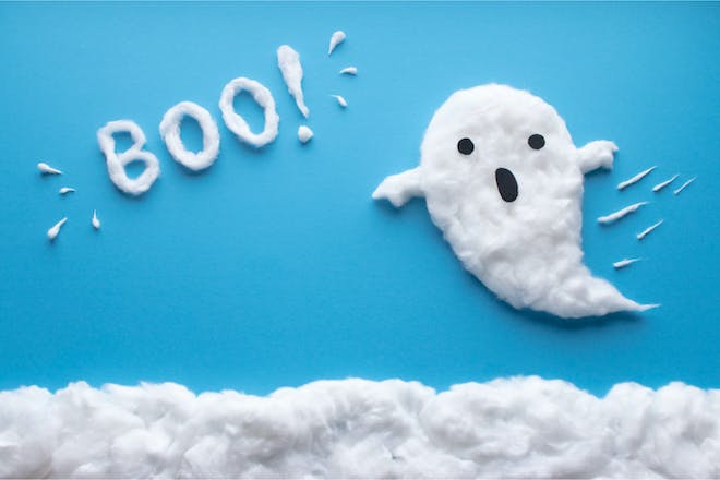 Cotton wool ghost against blue background with 'Boo' written beside it