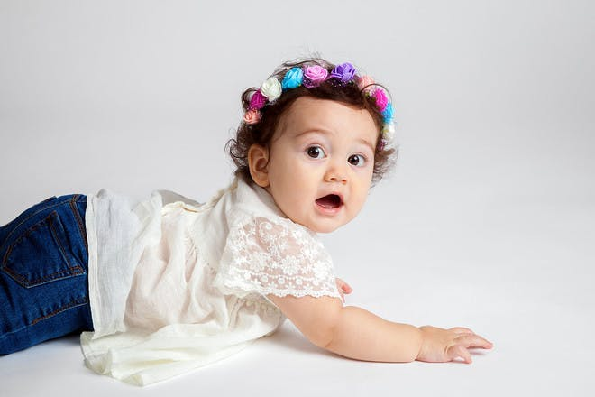 Baby girl lying shocked
