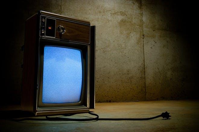 broken retro tv on side