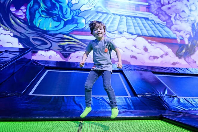 young boy bouncing on trampoline at Flip Out park in Brent Cross