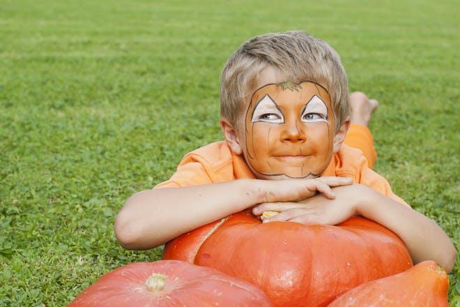 Halloween face paint for a cute pumpkin