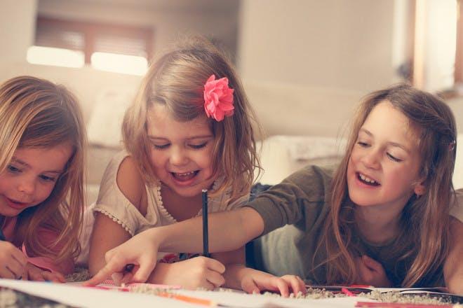 Three girls colouring
