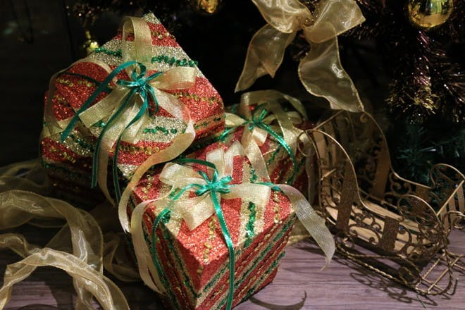 colourful gifts tied with gold and blue ribbons
