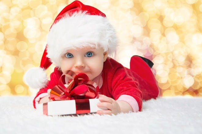 baby in christmas suit