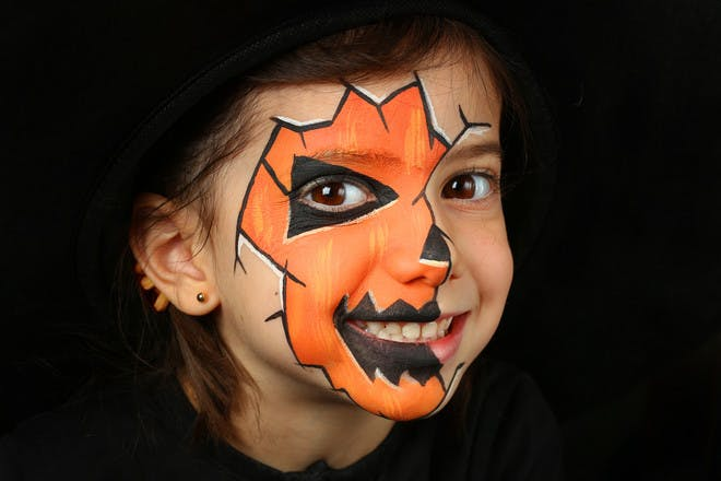 Halloween face paint for a scary pumpkin