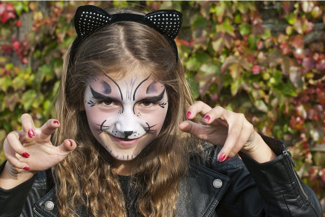 Girl dressed as a cat