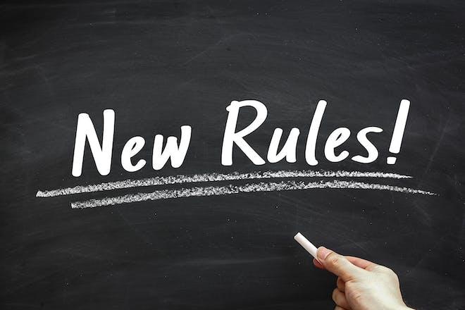 Blackboard saying 'New Rules!'