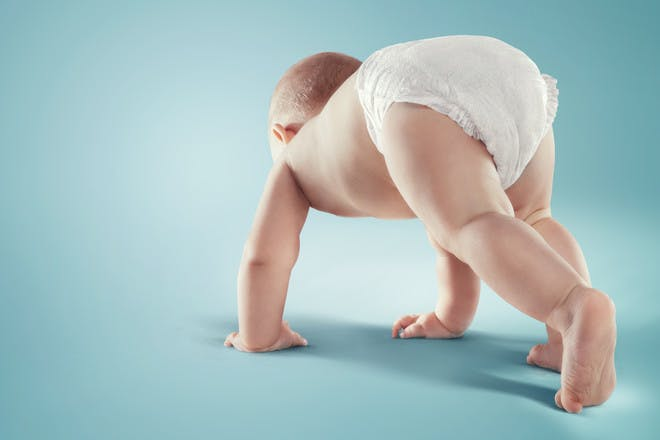 baby crawling in nappy
