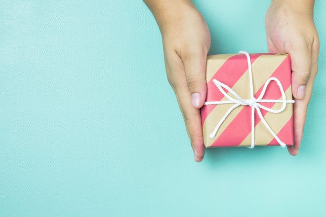 Two hands holding gift