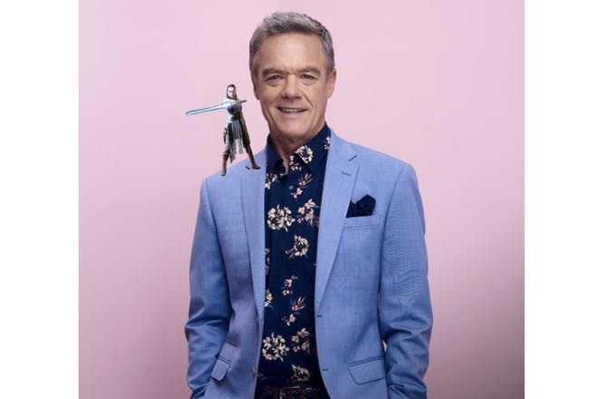 Neighbours character Paul Robinson with a Star Wars character photoshopped on his shoulder
