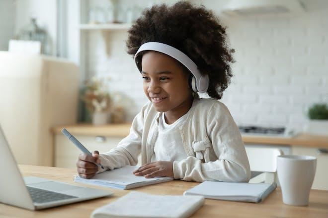 girl with headphones on laptop