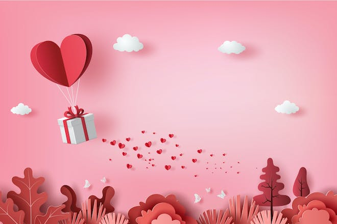 Love heart and gift on pink background