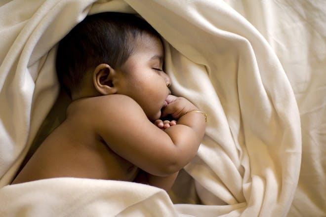 Baby sleeping in sheets