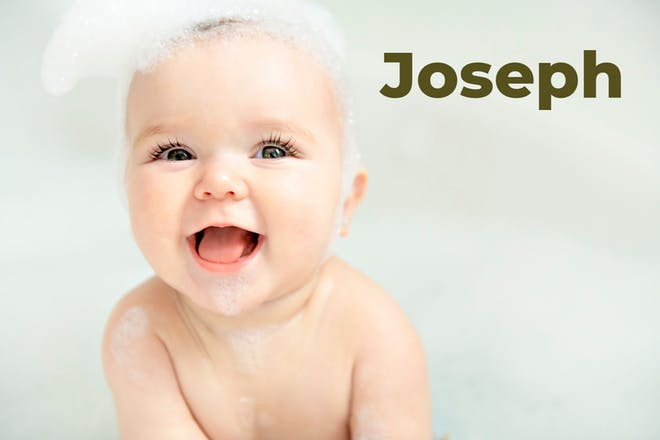 Baby in bath with bubbles on head. Name Joseph written in text