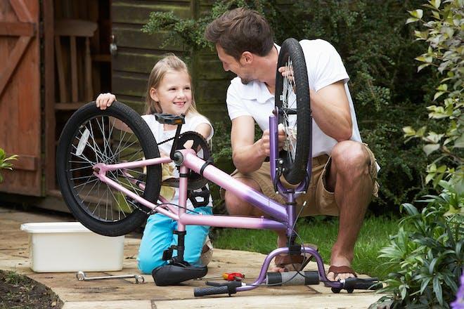 Girl cleaning bike