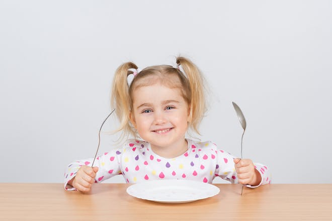 little girl with empty plate