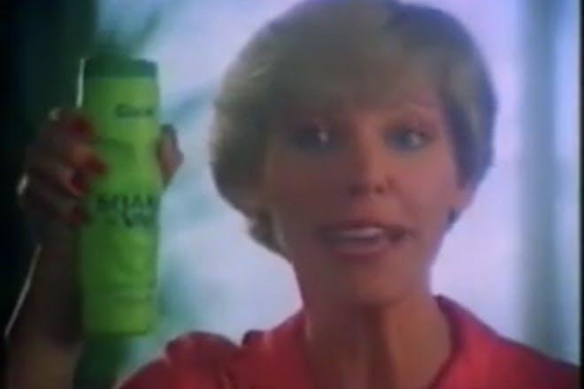 Woman holds tub of shake n vac