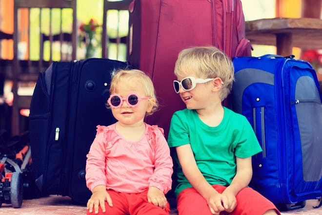 Children in sunglasses with suitcases