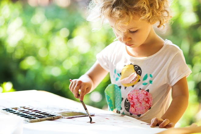 Girl painting outside
