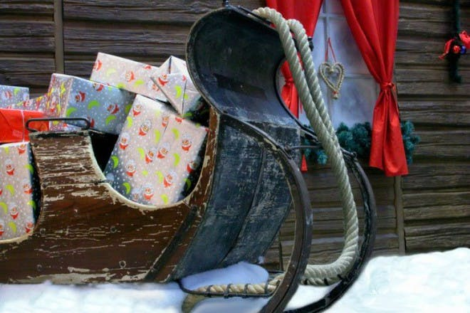 gifts in wooden sleigh