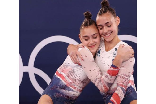Jennifer and Jessica Gadirova hugging at the Olympics