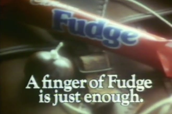A finger of fudge bar from a retro TV advert
