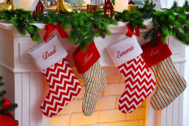 Christmas stockings hanging on mantlepiece