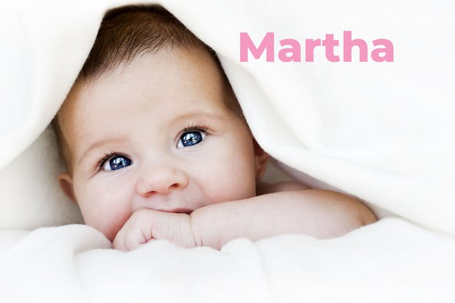 Baby under towel. Name Martha written in text