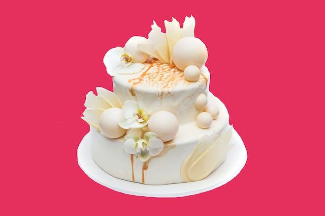 Wedding cake on pink background