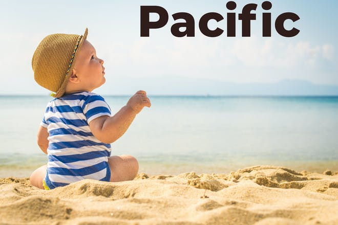 Baby on a beach with Pacific in text