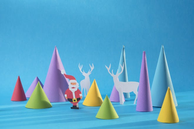 paper cone shapes made to look like christmas trees with a paper santa and reindeer