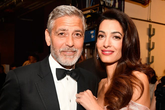 28. George and Amal Clooney