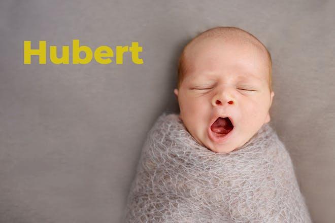 Yawning, swaddled baby. Name Hubert written in text