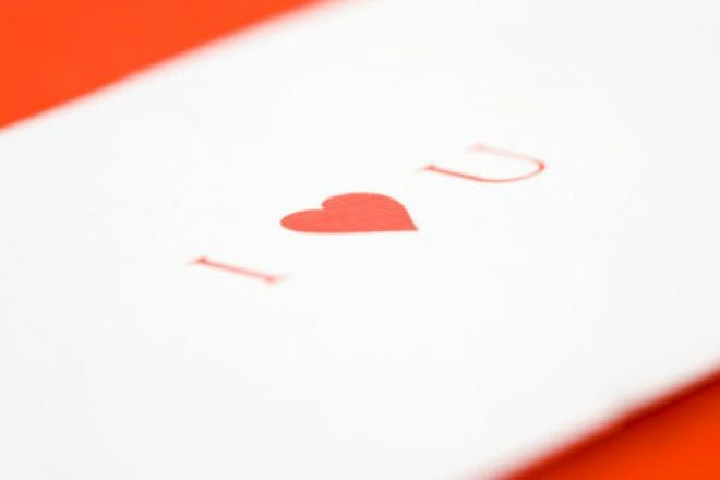 white love letter on red background