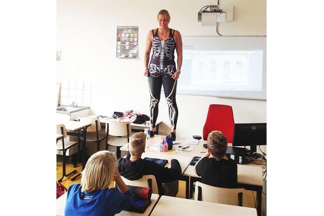 teacher wearing bodysuit skeleton