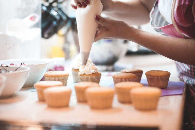 Woman baking cupcakes