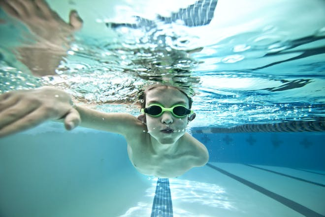 Young boy swimming under water