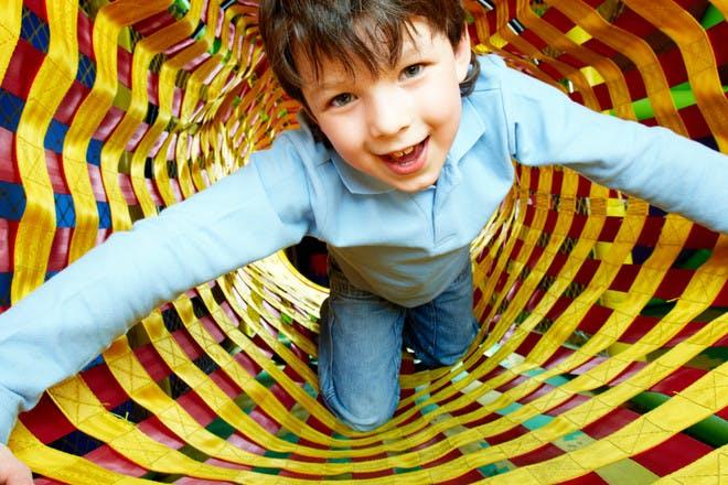child at adventure playground