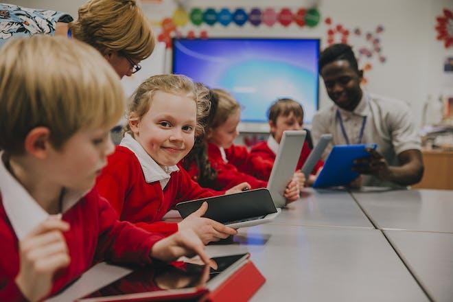 Children using tablets in primary school classroom