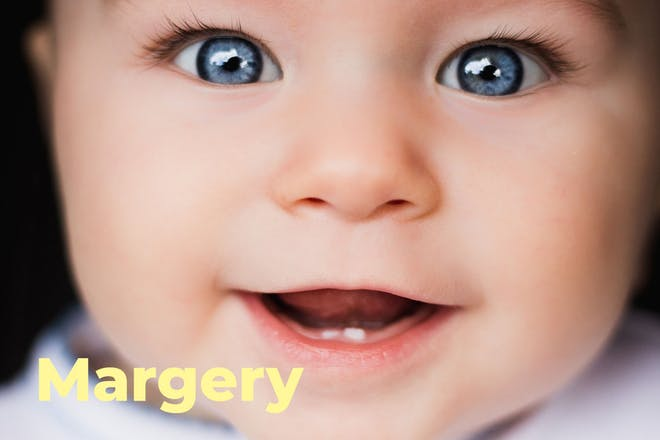 Close up of baby's face with name Margery written in text