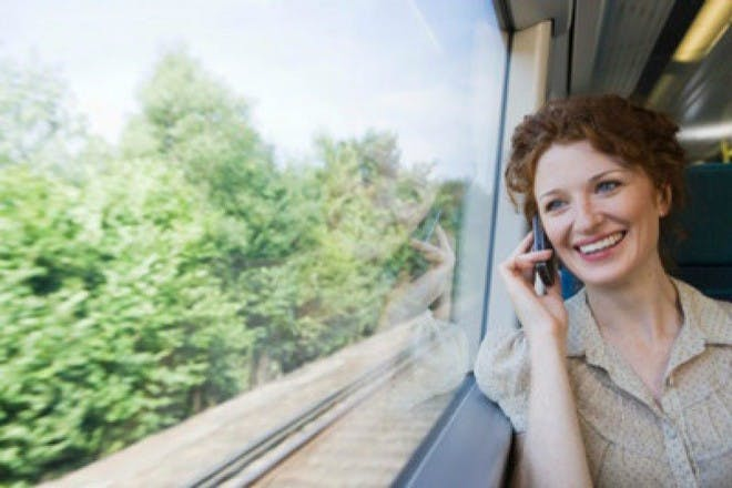 woman on train talking on mobile