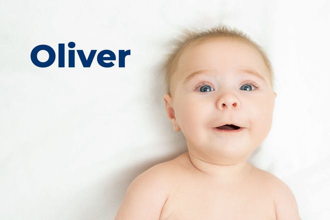 Baby lying down and looking up. Name Oliver written in text